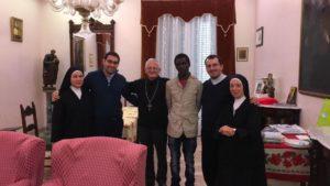 il-vescovo-pietro-maria-fragnelli-e-alcune-migranti2